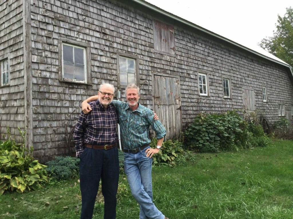 Clark Porter with his father in front of his great-great grandfather's barn. Clark's sons will be the sixth generation to be involved with their farm.