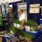 Sarah Carlson discussing cover crops at PFI Farm Progress Show booth 545x727