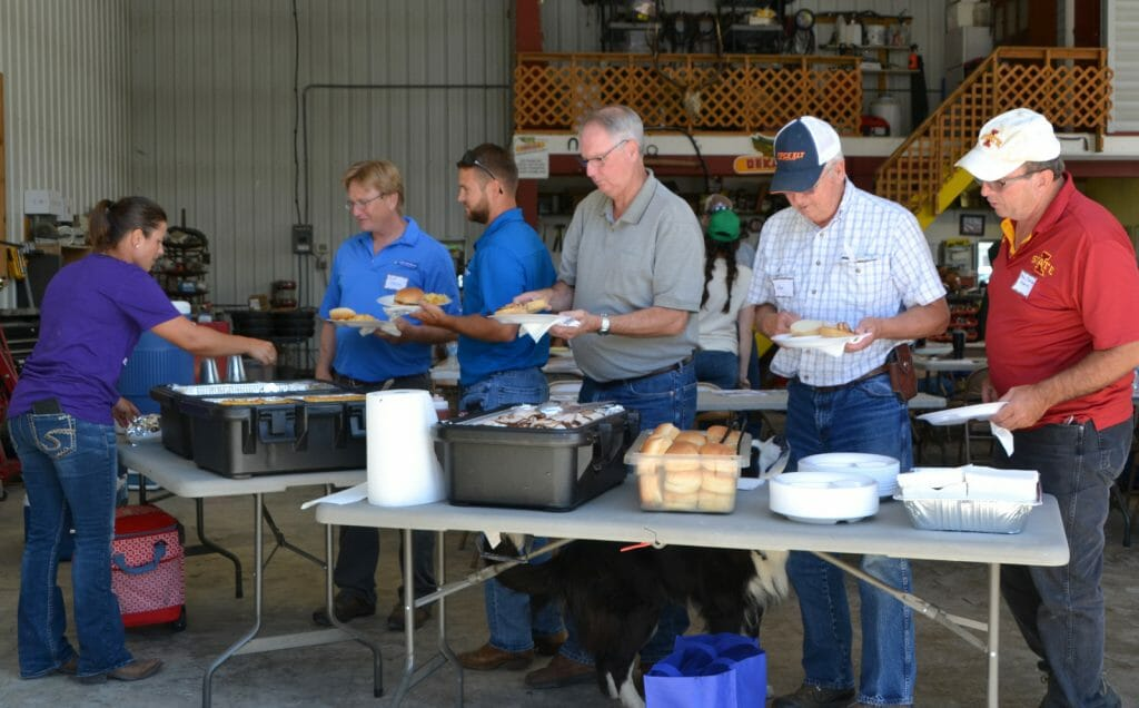 Guests enjoy barbecue pork sandwiches for lunch