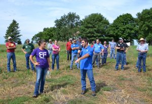 Showing guests a field that had cereal rye growing, which they baled earlier in the year