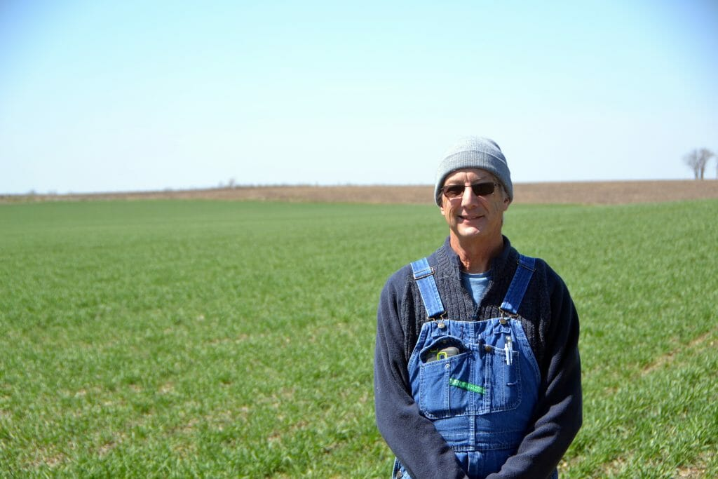 Dick sloan in front of wheat