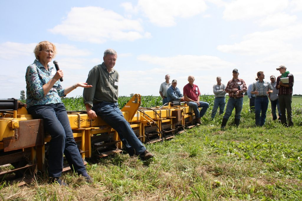 Margaret Smith and Doug Alert, of Ash Grove Farm, discuss organic crop production and cover crops at a field day they hosted.