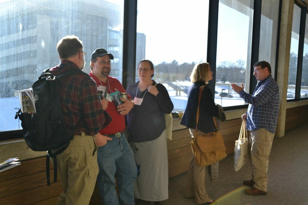 attendees of practical farmers of iowa annual conference networking between sessions