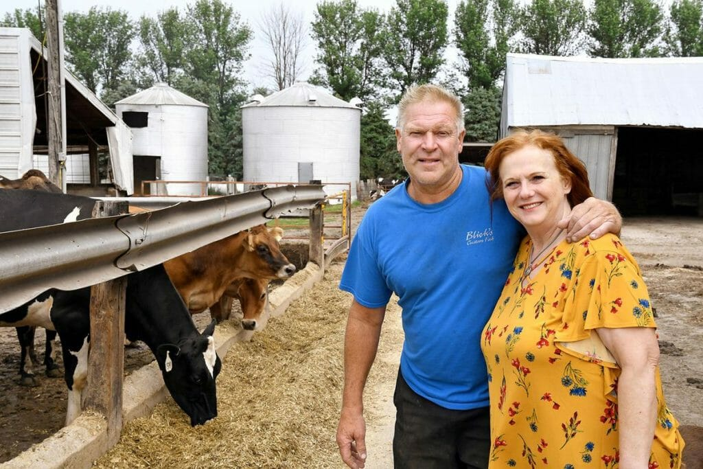 dairy cattle farmers Daryl and Marla De Groot with their dairy cattle on their farm near Hull Iowa