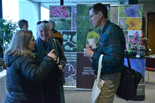 attendees networking between sessions at practical farmers of iowa annual conference 2019