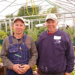 Jeff and Earl Hafner in aquaponics greenhouse