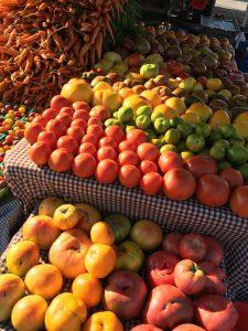 Rhizosphere farm several varieties of heirloom tomatoes at market