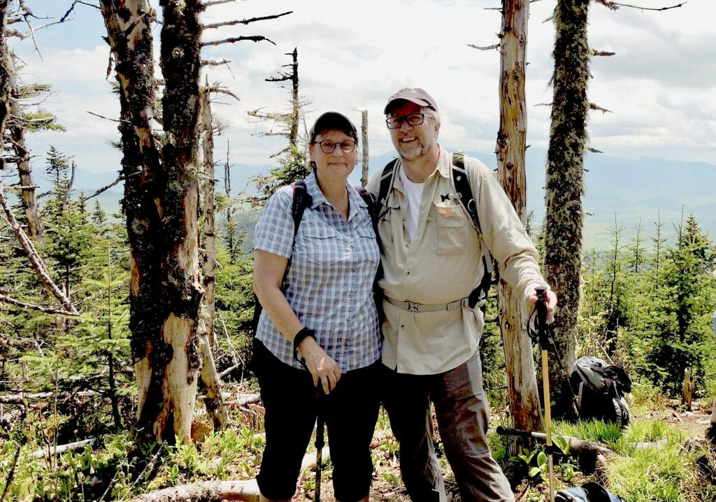 Linda Barnes and Mark Runquist hiking in New England lighting fix