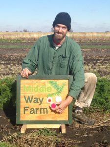 Jordan Scheibel posing with his Middle Way Farm sign submitted by him