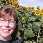 Ann Franzenburg by sunflowers