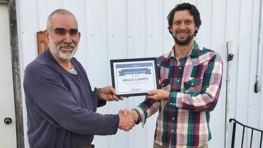 Bruce Carney, left, receiving 2019 Master Researcher Award from Stefan Gailans