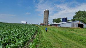 Neil LAST NAME, Peg Bouska's grand nephew, walks on the family farm shared by Peg