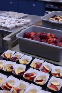 Locally grown apples being prepared for kids