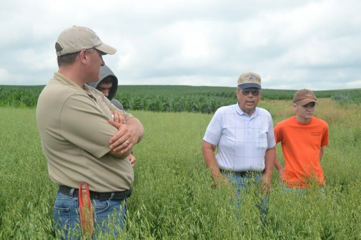 Paul Ackley lends some advice at David Carbaugh's field day.