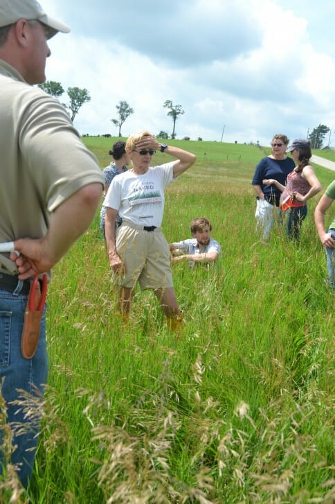 Attendees at David Carbaugh's field day discuss pasture mixes, cattle breeds, and fencing strategies.