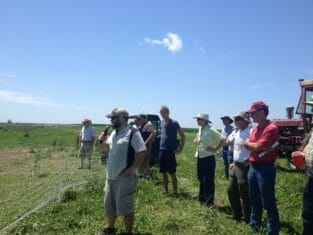 Justin Wade shows field day attendees his pastured poultry hoopie