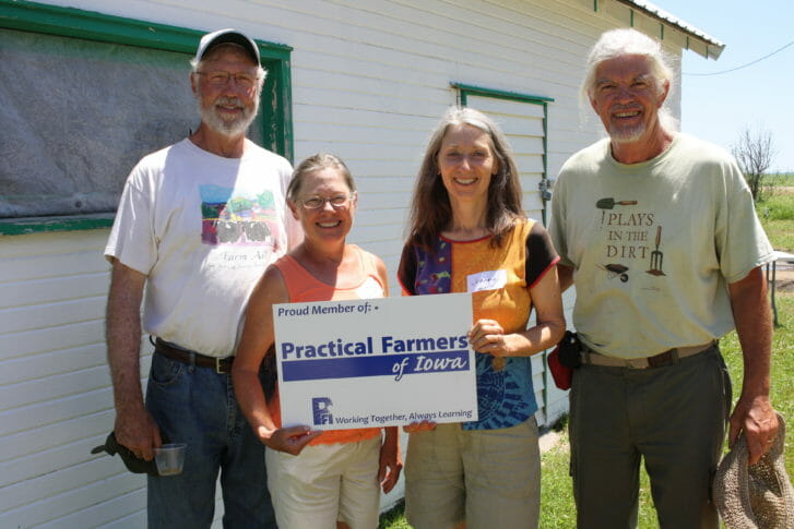 """George Naylor, Patti Edwardson, Joanna Hunter and Billy Sammons hosted the field day """"Effects of a Custom-Made Roller-Crimper on Rye Cover"""" on June 15 near Churdan."""