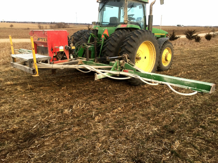 Doug Alert built this dedicated toolbar for frost seeding red clover. It's a Gandy Orbit-Air seed hopper mounted on a used sprayer boom with a hydraulic metering system.